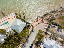Tourists return to the Southernmost Point after Hurricane Irma. Aerial image of tourists returning to Key West Southernmost Point buoy after Hurricane Irma Stock Images