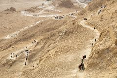 A  tourists returning from the  Masada on the snake path in the Stock Image