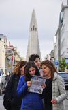 Tourists in Reykjavik, Iceland. Tourists looking at the map in Reykjavik, Icelend Stock Photos