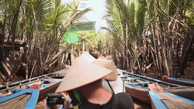 Tourists ride on a boat on the Mekong River Delta. Vietnam. Shot in Full HD - 1920x1080, 30fps stock video footage