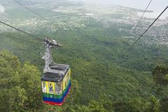 Tourists ride the cable car to the top of Pico Isabel de Torres, Puerto Plata, Dominican Republic. Royalty Free Stock Photo