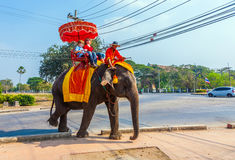 Tourists ride on an elephant. AYUTTHAYA, THAILAND DEC 23: tourists ride on an elephant in the Historical Park on DEC 23, 2009 in Ajutthaya, Thailand. It is Stock Image