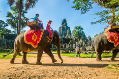 Tourists ride elephant on howdah chair, Cambodia Royalty Free Stock Image