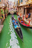Tourists ride on a gondola Stock Photography