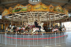 Tourists ride at historical B&B carousel  at Coney Island Boardwalk in Brooklyn. Stock Image
