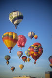 Tourists ride hot air balloons Stock Photo