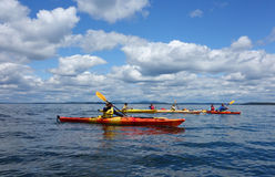 Tourists ride sea kayaks in Bar Harbor, Maine Stock Images