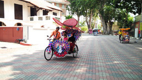 Tourists ride on Trishaw Royalty Free Stock Images