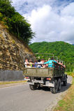 Tourists ride a truck in the mountains Stock Photography