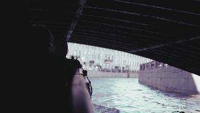 Tourists ride under bridges through the canals of St. Petersburg. slow motion, 1920x1080, full hd. Tourists ride under bridges through the canals of St stock footage