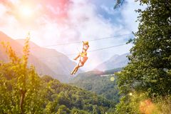 Tourists ride on the Zipline stock photo