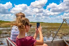 Tourists riding airboat and admiring nature in the Everglades stock images