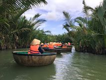Tourists riding bamboo basket boats in Hoi An,vietnam royalty free stock photography