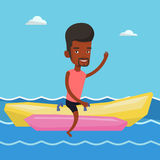 Tourists riding a banana boat vector illustration. Stock Images