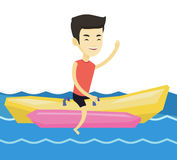 Tourists riding a banana boat vector illustration. Royalty Free Stock Images