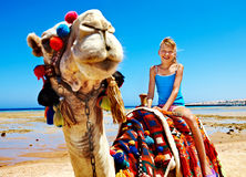 Tourists riding camel  on the beach of  Egypt. Stock Photo
