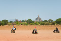 Tourists riding E-Bike in Bagan Royalty Free Stock Photo