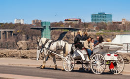 Tourists riding on a horse carriage in Niagara Falls Royalty Free Stock Photos