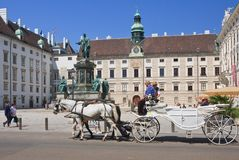 Tourists riding horse-drawn carriage. Hofburg.Vienna, Austria Royalty Free Stock Photography