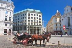 Tourists riding horse-drawn carriage. Hofburg.Vienna, Austria Royalty Free Stock Image