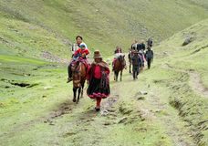 Tourists riding horse in Peru green mountain valley Royalty Free Stock Images