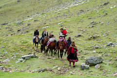 Tourists riding horse in Peru green mountain valley Stock Photos