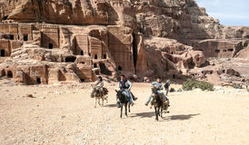 Tourists riding a horse. In the ruins of Petra, is an editorial image  on a sunny day Royalty Free Stock Photography