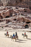 Tourists riding a horse Stock Images