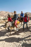 Tourists riding a horse Royalty Free Stock Photography