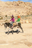 Tourists riding a horse Royalty Free Stock Images