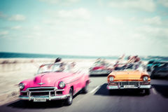 Tourists riding in oldtimer car in Havana. Concept of Cuba attra. Ctions. Shallow DOF, filter applied. Toned, horizontal Stock Photography