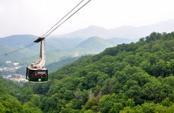 Tourists riding the scenic gondola cable car at Ober Gatlinburg in Tennessee Stock Photo