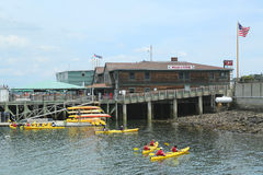 Tourists riding sea kayaks in Bar Harbor Royalty Free Stock Images