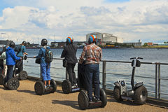 Tourists riding segways Stock Photos