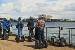 Tourists riding segways Stock Photos
