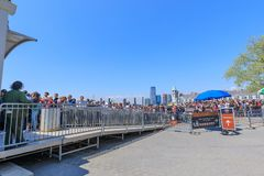 Tourists riding Statue Cruises ferry boat at Battery park in lower Manhattan in NYC Royalty Free Stock Photos