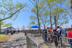 Tourists riding Statue Cruises ferry boat at Battery park in lower Manhattan in NYC Stock Photography
