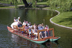Tourists riding the Swan Boats Stock Images