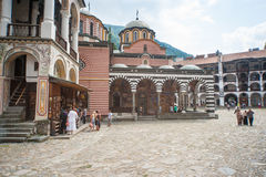 Tourists at the Rila Monastery in Bulgaria Stock Images