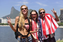 Tourists in Rio de Janeiro with Christ the Redeemer in background. North American group of tourists in Rio de Janeiro Brazil with Christ the Redeemer in Stock Photos