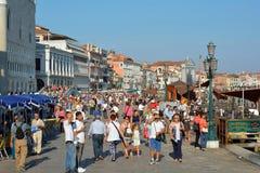 Tourists on the Riva degli Schiavoni of Venice - Italy. Royalty Free Stock Photo