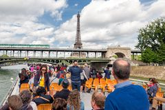 Tourists at river cruise admiring Eiffel tower Paris Royalty Free Stock Photo