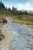 Tourists and river on the road in the Altai mountains, Russia Royalty Free Stock Image