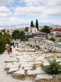 Tourists on road in Ancient Agora area in Athens Royalty Free Stock Images