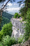 Tourists on the rock in Slovak paradise royalty free stock image
