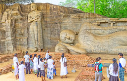 Tourists in Rock Temple of Polonnaruwa stock photo