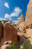 Tourists in rocks in Cappadocia, Turkey Stock Photos