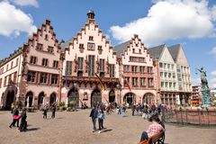 Tourists on Roemerberg square in Frankfurt Stock Photo