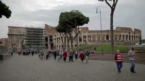 Tourists in Rome, Italy. Tourists from other countries just coming from sightseeing greatest The Colosseum in Rome, Italy stock video