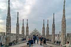 Tourists on the roof of Duomo Cathedral in Milan, Italy Stock Photography